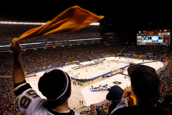 PITTSBURGH, PA - JANUARY 01:  A fan of the Pittsburgh Penguins waves his 'terrible towel' as he cheers during the 2011 NHL Bridgestone Winter Classic against the Washington Capitals at Heinz Field on January 1, 2011 in Pittsburgh, Pennsylvania.  (Photo by