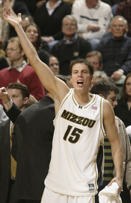 COLUMBIA, MO - JANUARY 20:  Josh Kroenke #15 of the Missouri Tigers encourages his teammates in the first half against the Texas Long Horns on January 20, 2004 at the Hearnes Center in Columbia, Missouri.  (Photo by Elsa/Getty Images)