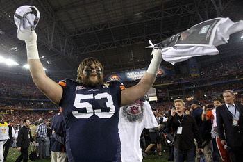 GLENDALE, AZ - JANUARY 10:  Bart Eddins #53 of the Auburn Tigers celebrates the Tigers 22-19 victory against the Oregon Ducks in the Tostitos BCS National Championship Game at University of Phoenix Stadium on January 10, 2011 in Glendale, Arizona.  (Photo