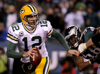 PHILADELPHIA, PA - JANUARY 09:  Aaron Rodgers #12 of the Green Bay Packers scrambles against the Philadelphia Eagles during the 2011 NFC wild card playoff game at Lincoln Financial Field on January 9, 2011 in Philadelphia, Pennsylvania.  (Photo by Nick La