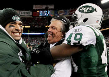 EAST RUTHERFORD, NJ - JANUARY 03:  Quarterback  Mark Sanchez #6, head coach Rex Ryan and Tony Richardson #49 of the New York Jets celebrate their 37-0 victory over the Cincinnati Bengals at Giants Stadium on January 3, 2010 in East Rutherford, New Jersey.