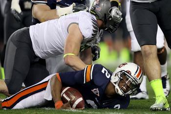 GLENDALE, AZ - JANUARY 10:  Quarterback Cameron Newton #2 of the Auburn Tigers gets up after being tacked in the first quarter against the Oregon Ducks during the Tostitos BCS National Championship Game at University of Phoenix Stadium on January 10, 2011