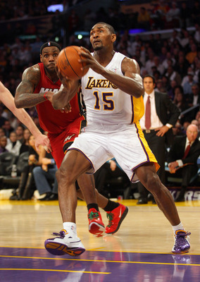 LOS ANGELES, CA - DECEMBER 25:  Ron Artest #15 of the Los Angeles Lakers steps to the basket as LeBron James #6 of the Miami Heat tries to defend the play during the NBA game at Staples Center on December 25, 2010 in Los Angeles, California. The Heat defe