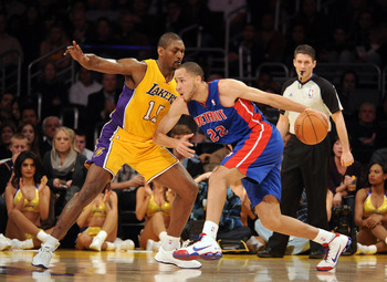 LOS ANGELES, CA - JANUARY 04:  Tayshaun Prince #22 of the Detroit Pistons dribbles in front of Ron Artest #15 of the Los Angeles Lakers during a 108-83 Laker win at the Staples Center on January 4, 2011 in Los Angeles, California. NOTE TO USER: User expre