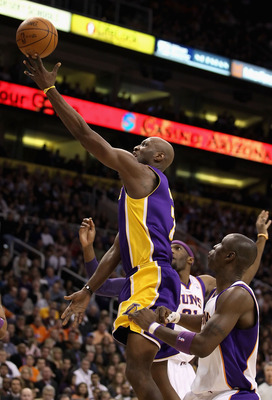 PHOENIX - JANUARY 05: Lamar Odom #7 of the Los Angeles Lakers lays up a shot against the Phoenix Suns during the NBA game at US Airways Center on January 5, 2011 in Phoenix, Arizona. The Lakers defeated the Suns 99-95. NOTE TO USER: User expressly acknowl