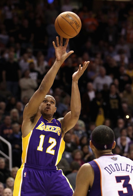 PHOENIX - JANUARY 05: Shannon Brown #12 of the Los Angeles Lakers puts up a shot over Jared Dudley #3 of the Phoenix Suns during the NBA game at US Airways Center on January 5, 2011 in Phoenix, Arizona. The Lakers defeated the Suns 99-95. NOTE TO USER: Us