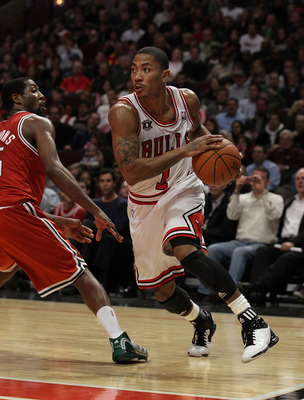 CHICAGO, IL - DECEMBER 28: Derrick Rose #1 of the Chicago Bulls moves around John Salmons #15 of the Milwaukee Bucks at the United Center on December 28, 2010 in Chicago, Illinois. The Bulls defeated the Bucks 90-77. NOTE TO USER: User expressly acknowled