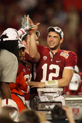 MIAMI, FL - JANUARY 03: Orange Bowl MVP Andrew Luck #12 of the Stanford Cardinal celebrates with his teammates after Stanford won 40-12 against the Virginia Tech Hokies during the 2011 Discover Orange Bowl at Sun Life Stadium on January 3, 2011 in Miami,