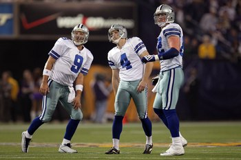 MINNEAPOLIS - JANUARY 17:  Quarterback Tony Romo #9, Shaun Suisham #4 and Jason Witten #82 of the Dallas Cowboys look on while playing against the Minnesota Vikings during the NFC Divisional Playoff Game at Hubert H. Humphrey Metrodome on January 17, 2010