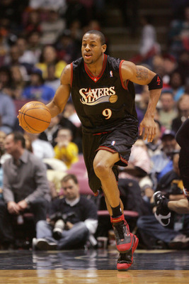 EAST RUTHERFORD, NJ - DECEMBER 10:  Andre Iguodala  #9 of the Philadelphia 76ers moves the ball up court during a game against the New Jersey Nets at Continental Airlines Arena on December 10, 2005 in East Rutherford, New Jersey.  The Sixers defeated the