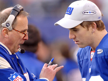 New York Giants quarterback Eli Manning talks with offensive coordinator John Hufnagel during an NFC wildcard game January 8, 2006 at the Meadowlands. The Panthers defeated the Giants 23 - 0.  (Photo by Al Messerschmidt/Getty Images)