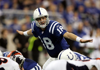 INDIANAPOLIS - JANUARY 09:  Quarterback Peyton Manning #18 of the Indianapolis Colts signals to his team during the fourth quarter against the Denver Broncos in the AFC Wildcard playoff game at the RCA Dome on January 9, 2005 in Indianapolis, Indiana.  Th