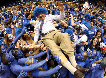 DURHAM, NC - MARCH 06:  ESPN analyst Dick Vitale surfs the crowd with the Cameron Crazies before the start of the game between the North Carolina Tar Heels and Duke Blue Devils at Cameron Indoor Stadium on March 6, 2010 in Durham, North Carolina.  (Photo