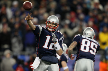 FOXBORO, MA - DECEMBER 06:  Tom Brady #12 of the New England Patriots throws a pass against the New York Jets at Gillette Stadium on December 6, 2010 in Foxboro, Massachusetts.  (Photo by Elsa/Getty Images)