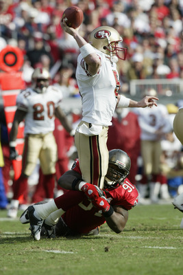 TAMPA, FL - JANUARY 12:  Quarterback Jeff Garcia #5 of the San Francisco 49ers gets hit by Chartric Darby #91 of the Tampa Bay Buccaneers in the NFC Divisional Playoff game at Raymond James Stadium on January 12, 2002 in Tampa, Florida. The Buccaneers def