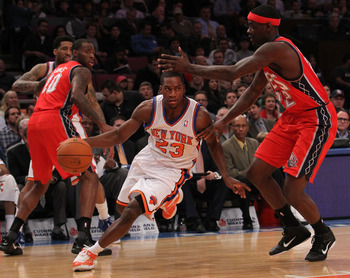 NEW YORK, NY - NOVEMBER 30:  Toney Douglas #23 of the New York Knicks drives to the basket against Anthony Morrow #22 of the New Jersey Nets on November 30, 2010 at Madison Square Garden in New York City. NOTE TO USER: User expressly acknowledges and agre
