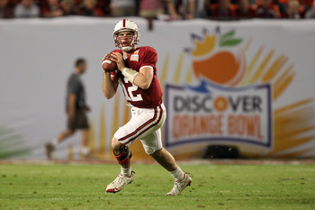 MIAMI, FL - JANUARY 03: Andrew Luck #12 of the Stanford Cardinal rolls out of the pocket to pass against the Virginia Tech Hokies during the 2011 Discover Orange Bowl at Sun Life Stadium on January 3, 2011 in Miami, Florida. (Photo by Streeter Lecka/Getty