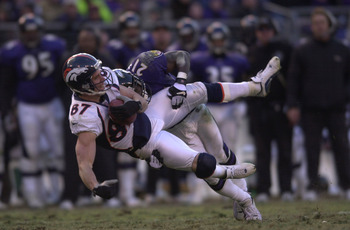 31 Dec 2000:  Ed McCaffery #87 of the Denver Broncos is tackled by Chris McAlister #21 of the Baltimore Ravens in the AFC Wildcard playoff game at PSINet Stadium in Baltimore, Maryland. The Ravens won 21-3. DIGITAL IMAGE Mandatory Credit: Doug Pensinger/A