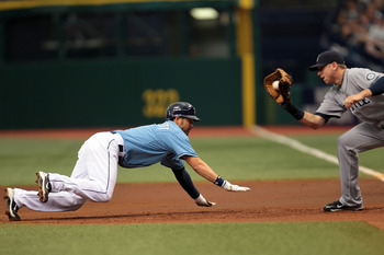 ST PETERSBURG, FL - SEPTEMBER 26: Jason Bartlett #8 of the Tampa Bay Rays is tagged out at first base by Justin Smoak #17 of the Seattle Mariners at Tropicana Field on September 26, 2010 in St. Petersburg, Florida. (Photo by Eliot J. Schechter/Getty Image