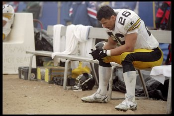 5 Jan 1997: Defensive back Rod Woodson of the Pittsburgh Steelers sits dejected on the bench during the Steelers 28-3 AFC playoff loss to the New England Patriots at Foxboro Stadiium in Foxboro, Massachusetts