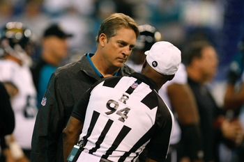 INDIANAPOLIS, IN - DECEMBER 19: Jack Del Rio of the Jacksonville Jaguars talks with Mike Carey #94 during pregame warm ups prior to the game against the Indianapolis Colts at Lucas Oil Stadium on December 19, 2010 in Indianapolis, Indiana.  (Photo by Scot