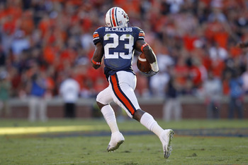 AUBURN - OCTOBER 16:  Kick returner Onterio McCalebb of the Auburn Tigers runs for a 99 yard kick return during the game against the Arkansas Razorbacks at Jordan-Hare Stadium on October 16, 2010 in Auburn, Alabama.  The Tigers beat the Razorbacks 65-43.