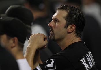 CHICAGO - AUGUST 10: Paul Konerko #14 of the Chicago White Sox watches from the dugout as his teammates take on the Minnesota Twins at U.S. Cellular Field on August 10, 2010 in Chicago, Illinois. The Twins defeated the White Sox 12-6. (Photo by Jonathan D