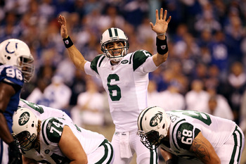 INDIANAPOLIS, IN - JANUARY 08:  Quarterback Mark Sanchez #6 of the New York Jets gestures as he steps to the line of scrimmage against the Indianapolis Colts during their 2011 AFC wild card playoff game at Lucas Oil Stadium on January 8, 2011 in Indianapo