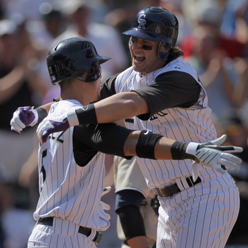 DENVER - SEPTEMBER 15:  Troy Tulowitzki #2 of the Colorado Rockies celebrates his three run home run with Carlos Gonzalez #5 who scored on the play as the Rockies took a 5-1 lead over the San Diego Padres in the third inning at Coors Field on September 15