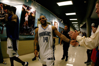 ORLANDO, FL - MAY 26:  Jammer Nelson #14 of the Orlando Magic celebrates as he walks back to the locker room after the Magic won 113-92 against the Boston Celtics in Game Five of the Eastern Conference Finals during the 2010 NBA Playoffs at Amway Arena on