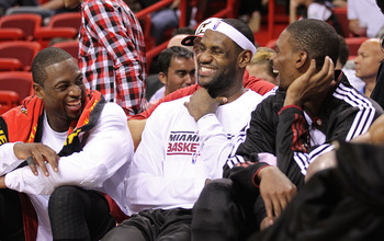 MIAMI - NOVEMBER 17:  LeBron James #6 and Dwyane Wade #3, and Chris Bosh #1 of the Miami Heat laugh on the bench during a game against the Phoenix Suns at American Airlines Arena on November 17, 2010 in Miami, Florida. NOTE TO USER: User expressly acknowl