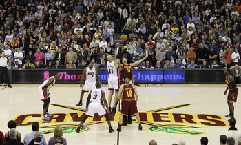 CLEVELAND, OH - DECEMBER 02:  Anderson Varejao #17 of the Cleveland Cavaliers jumps for the opening tip against Zydrunas Ilgauskas #11 of the Miami Heat with LeBron James #6 looking on at Quicken Loans Arena on December 2, 2010 in Cleveland, Ohio. NOTE TO