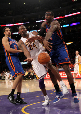 LOS ANGELES, CA - JANUARY 09:  Amar'e Stoudemire #1 of the New York Knicks knocks the ball away from Kobe Bryant #24 of the Los Angeles Lakers at Staples Center on January 9, 2011 in Los Angeles, California.  The Lakers won 109-87.   NOTE TO USER: User ex
