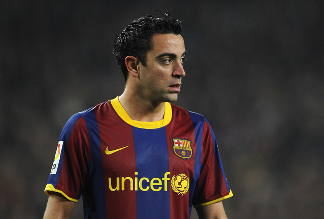 BARCELONA, SPAIN - JANUARY 16:  Xavi Hernandez of FC Barcelona looks on during the La Liga match between FC Barcelona and Malaga at Nou Camp on January 16, 2011 in Barcelona, Spain. Barcelona won 4-1.  (Photo by David Ramos/Getty Images)