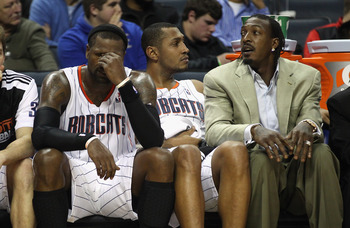 CHARLOTTE, NC - DECEMBER 21:  Teammates Matt Carroll #33, Stephen Jackson #1, Boris Diaw #32 and Gerald Wallace #3 of the Charlotte Bobcats sit on the bench during their 99-81 loss to the Oklahoma City Thunder at Time Warner Cable Arena on December 21, 20