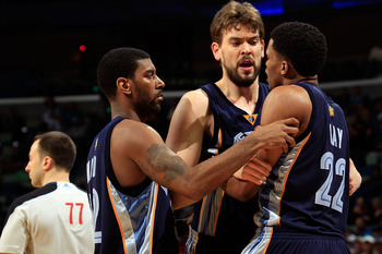 NEW ORLEANS - MARCH 03:  O.J. Mayo #32 and Marc Gasol #33 hold back Rudy Gay #22 of the Memphis Grizzlies after drawing a technical foul for arguing with a referee during the game against the New Orleans Hornets at the New Orleans Arena on March 3, 2010 i