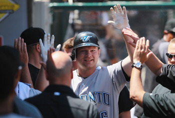 ANAHEIM, CA - AUGUST 15:  Adam Lind #26 of the Toronto Blue Jays receives high fives in the dugout after hitting a solo home run in the second inning against the Los Angeles Angels of Anaheim at Angel Stadium on August 15, 2010 in Anaheim, California.  (P