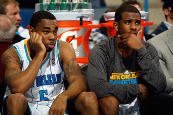 NEW ORLEANS, LA - DECEMBER 29:  Chris Paul #3 and Marcus Thornton #5 of the New Orleans Hornets react after losing to the Los Angeles Lakers 103-88 at the New Orleans Arena on December 29, 2010 in New Orleans, Louisiana.   NOTE TO USER: User expressly ack