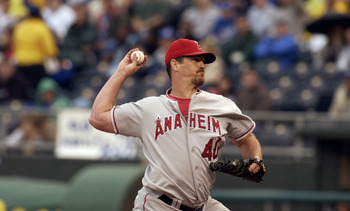 KANSAS CITY, MO - AUGUST 31:  Troy Percival #40 of the Anaheim Angels throws against the Kansas City Royals in the ninth inning of the game on August 31, 2003 at Kauffman Stadium in Kansas City, Missouri.  Percival retired the two batters he faced to earn