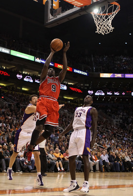 PHOENIX - NOVEMBER 24:  Luol Deng #9 of the Chicago Bulls puts up a shot over Jason Richardson #23 of the Phoenix Suns during the NBA game at US Airways Center on November 24, 2010 in Phoenix, Arizona. NOTE TO USER: User expressly acknowledges and agrees
