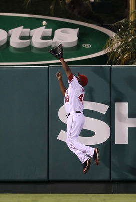 ANAHEIM, CA - JULY 27:  Center fielder Torii Hunter #48 of the Los Angeles Angels of Anaheim jumps to take a home run away from Mike Cameron of the Boston Red Sox for the final out of the eighth inning on July 27, 2010 at Angel Stadium in Anaheim, Califor