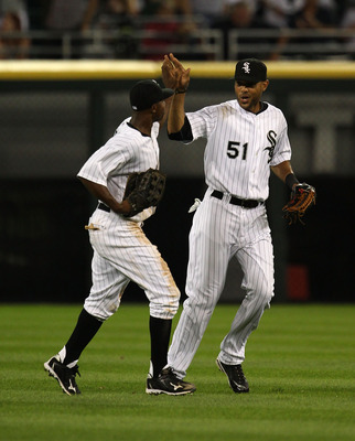 CHICAGO - JULY 26: Juan Pierre #1 (L) and Alex Rios #51 of the Chicago White Sox celebrate a win over the Seattle Mariners at U.S. Cellular Field on July 26, 2010 in Chicago, Illinois. The White Sox defeated the Mariners 6-1. (Photo by Jonathan Daniel/Get
