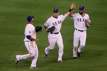 ARLINGTON, TX - OCTOBER 30:  (L-R) Nelson Cruz #17, Josh Hamilton #32 and Jeff Francoeur #21 of the Texas Rangers celebrate after their 4-2 win against the San Francisco Giants in Game Three of the 2010 MLB World Series at Rangers Ballpark in Arlington on