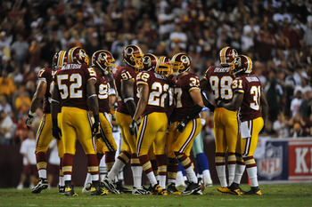 LANDOVER - SEPTEMBER 12:  The Washington Redskins defense huddles during the NFL season opener against the Dallas Cowboys at FedExField on September 12, 2010 in Landover, Maryland. The Redskins defeated the Cowboys 13-7. (Photo by Larry French/Getty Image