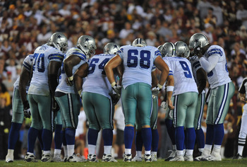 LANDOVER - SEPTEMBER 12:  The Dallas Cowboys offense huddles during the NFL season opener against the Washington Redskins at FedExField on September 12, 2010 in Landover, Maryland. The Redskins defeated the Cowboys 13-7. (Photo by Larry French/Getty Image