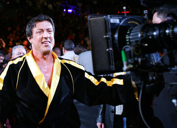 LAS VEGAS - DECEMBER 03:  Actor Sylvester Stallone walks into the ring as scenes from the film 'Rocky VI' are filmed before the start of the Bernard Hopkins and Jermain Taylor fight at the Mandalay Bay Events Center on December 3, 2005 in Las Vegas, Nevad