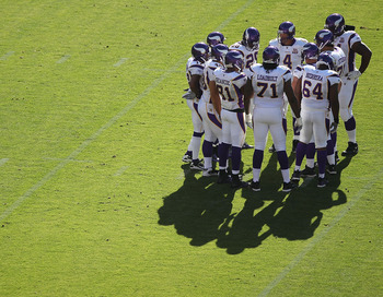 SAN FRANCISCO - AUGUST 22:  Brett Favre #4 of the Minnesota Vikings huddles with his teammates against the San Francisco 49ers during an NFL pre-season game at Candlestick Park on August 22, 2010 in San Francisco, California.  (Photo by Jed Jacobsohn/Gett