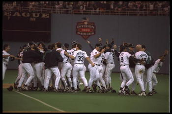 8 Oct 1995: The Seattle Mariners join-up on the field to celebrate after they clinch the American League Western Division. The Mariners defeated the New York Yankees 6-5 at the King Dome in Seattle, Wahington.