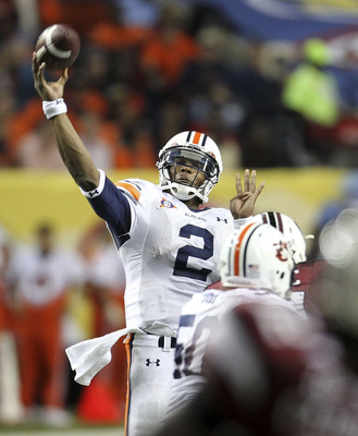 ATLANTA - DECEMBER 04:  Quarterback Cam Newton #2 of the Auburn Tigers passes the ball during the 2010 SEC Championship against the South Carolina Gamecocks at Georgia Dome on December 4, 2010 in Atlanta, Georgia.  (Photo by Mike Zarrilli/Getty Images)