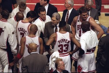 7 Jun 1998:  Coach Phil Jackson talks with Tony Kukoc, Jud Buechler, Luc Longley, Michael Jordan #23, Scottie Pippen #33, and Ron Harper of the Chicago Bulls during the NBA Finals Game 3 against the Utah Jazz at the United Center in Chicago, Illinois.  Th